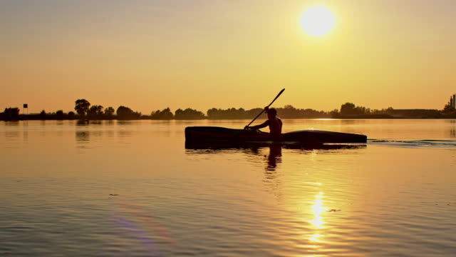 Silhouette of a kayaker on the lake