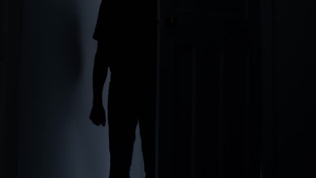 silhouette of a man entering a dark room, fist clenched. - one man only stock videos & royalty-free footage