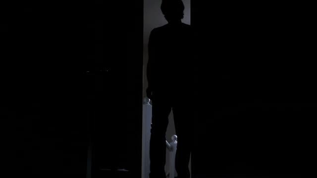silhouette of a man entering a dark room. - bedroom doorway stock videos & royalty-free footage