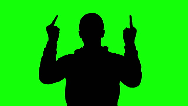 silhouette of a man showing middle fingers and thumbs down, chroma key - shock tactics stock videos and b-roll footage