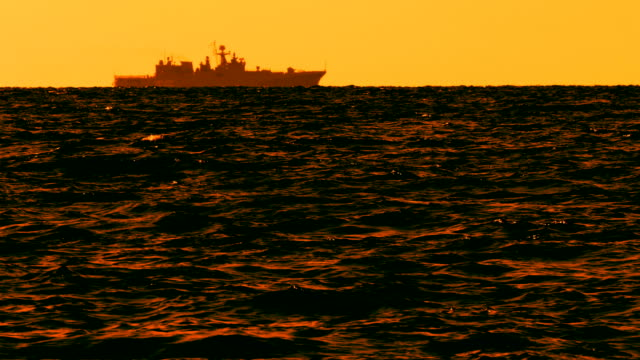 silhouette of a modern warship at sunset - missile stock videos & royalty-free footage