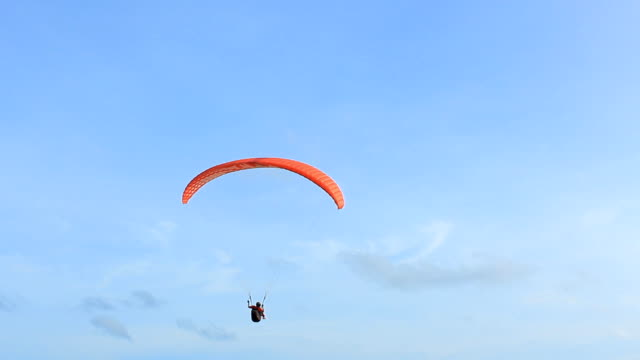 silhouette of a paraglider - parachute stock videos & royalty-free footage