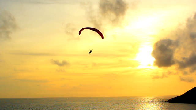 silhouette of a paraglider - parachuting stock videos & royalty-free footage