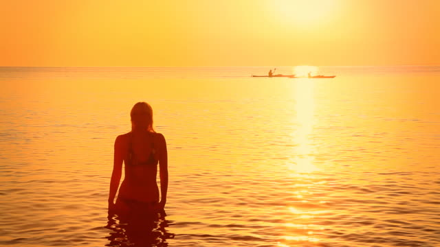 HD: Silhouette Of A Sensual Woman In Shallow Water