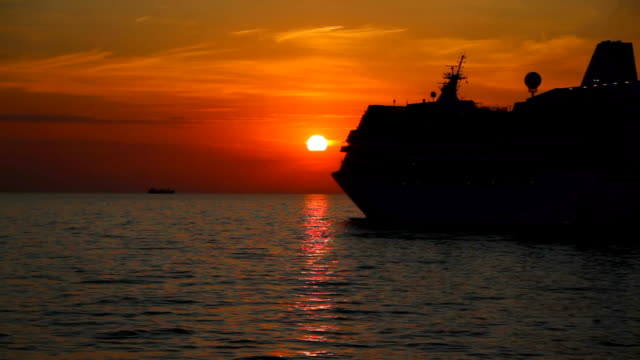 silhouette of a ship at sunset