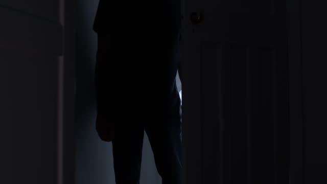 silhouette of a threatening man in a doorway. - child abuse stock videos & royalty-free footage