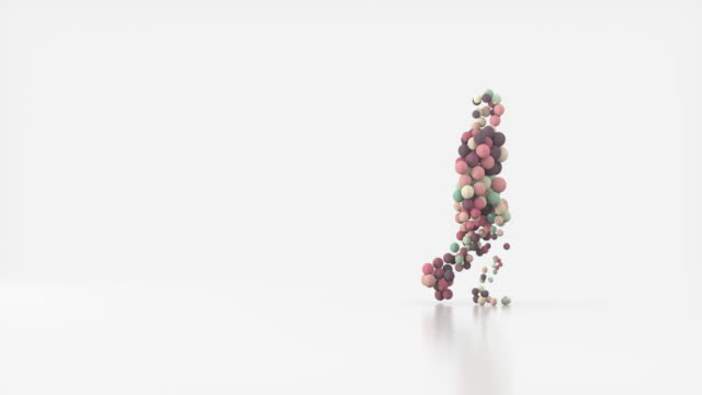 silhouette of a walking man consisting of colored balls of different sizes. - two dimensional shape stock videos & royalty-free footage