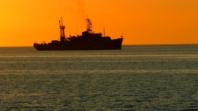 silhouette of a warship in the night sky - warship stock videos & royalty-free footage