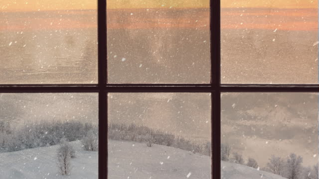 silhouette of a wooden window overlooking the evening winter forest. beautiful winter landscape with falling snow - snow stock videos & royalty-free footage