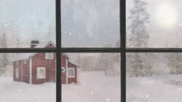 Silhouette of a wooden window overlooking the red house. Beautiful winter landscape with falling snow.