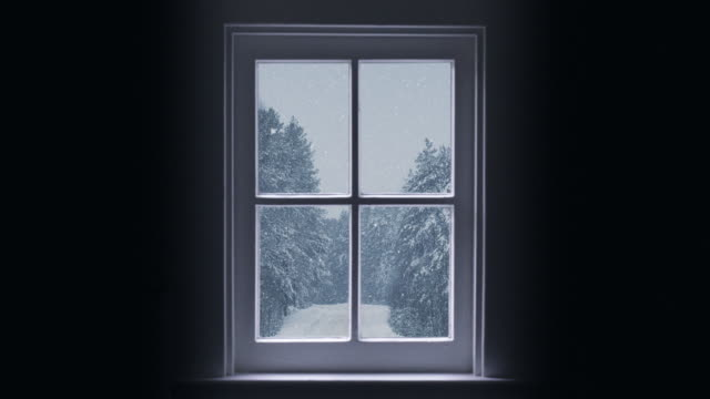 silhouette of a wooden window overlooking the winter forest. beautiful winter landscape with falling snow. - window frame stock videos and b-roll footage