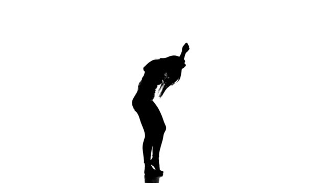 HD: Silhouette of a young dancing girl