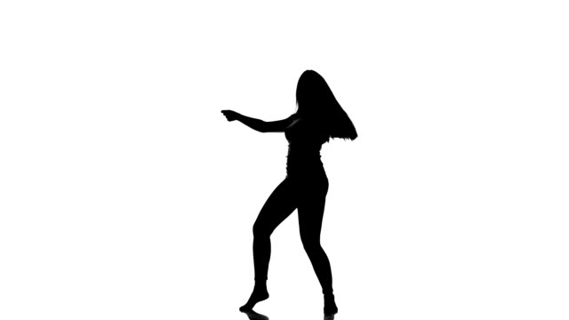 HD VIDEO: Silhouette of a young dancing girl