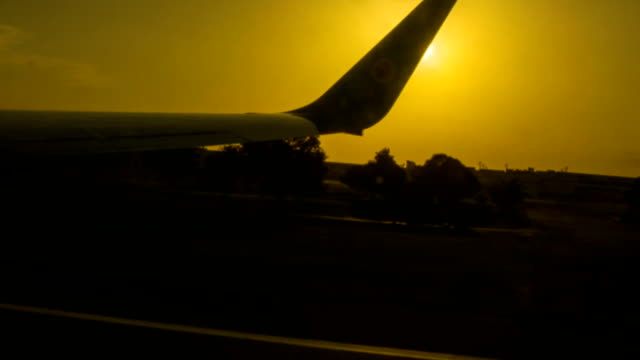 silhouette of aircraft wing - taxiway stock videos & royalty-free footage
