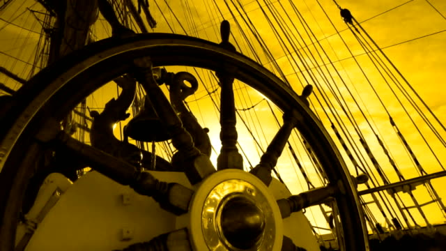 silhouette of an old ship's helm at sunset - helm stock videos & royalty-free footage
