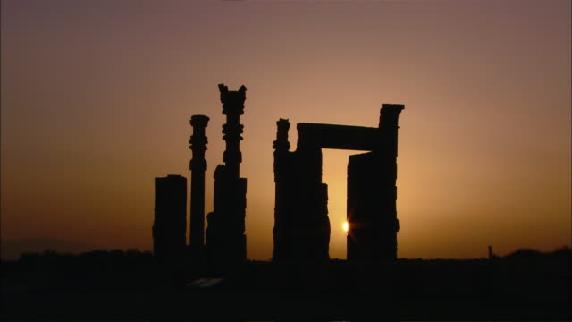WS Silhouette of ancient columns rising above ruins of Persepolis, Persepolis, Fars Province, Iran