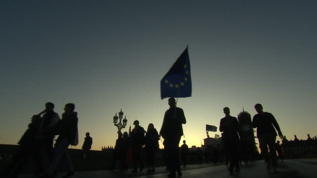 silhouette of anti brexit protesters walking over westminster bridge - brexit stock videos & royalty-free footage