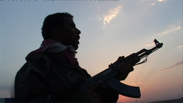 MS LA Silhouette of armed Iraqi soldier, Haditha, Al Anbar, Iraq