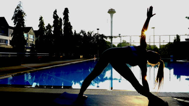 silhouette of asian sexy woman workout yoga and pilates , sun flare - deltoid stock videos and b-roll footage