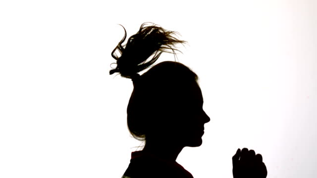 Silhouette of attractive woman bouncing