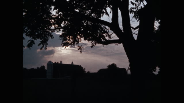 silhouette of barns at dusk - barn stock videos & royalty-free footage