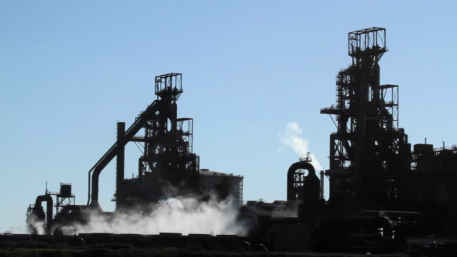 WS Silhouette of blast furnaces and steam / Port Talbot, Glamorgan, Wales, UK