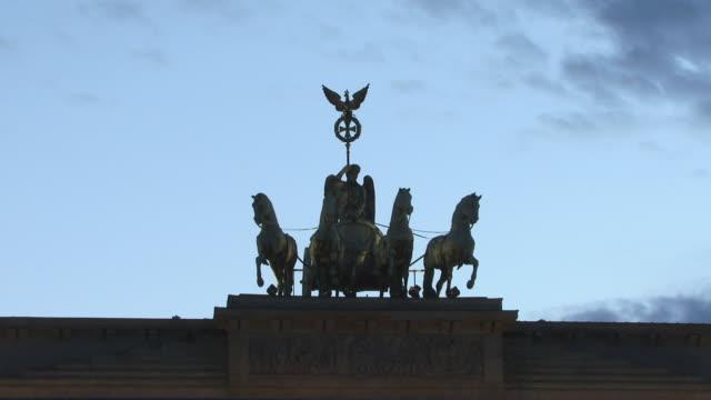 CU, ZO, WS Silhouette of Brandenburg Gate against dusky sky, Berlin, Germany