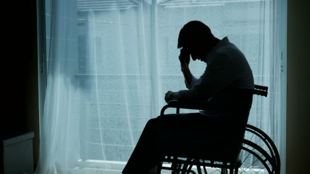 silhouette of business patient man on wheelchair , feel depressed
