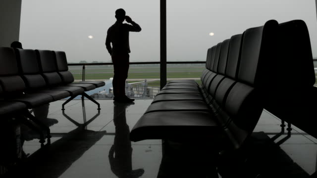 Silhouette of Businessman at airport