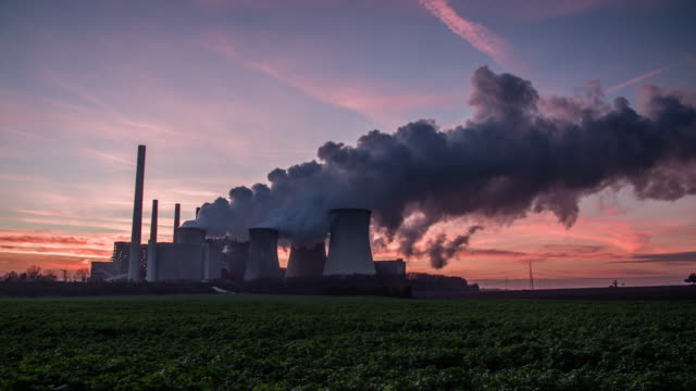 Silhouette of coal fired power station at sunset