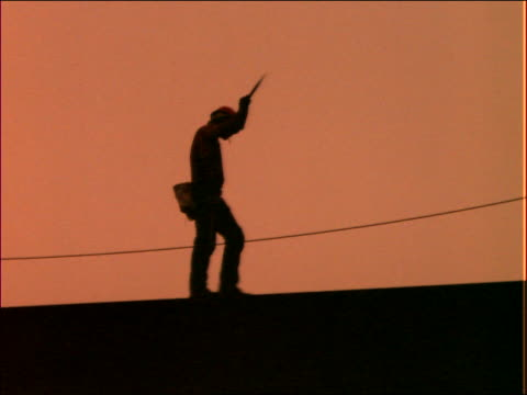 silhouette of construction worker walking on beam - only mid adult men stock videos & royalty-free footage