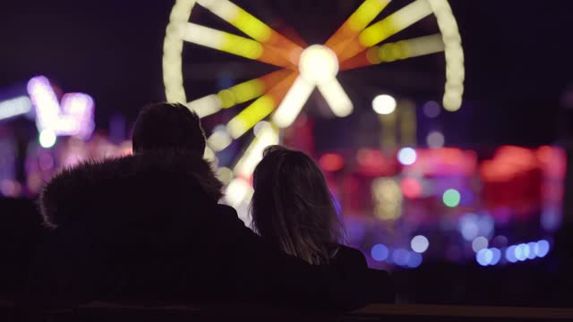 silhouette of couple kissing at amusement park at night, belfast, northern ireland, uk - amusement park stock videos & royalty-free footage