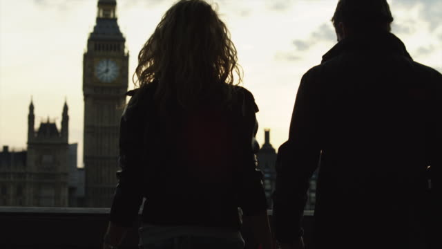ms silhouette of couple kissing in front of big ben at sunset / london, uk - falling in love stock videos & royalty-free footage