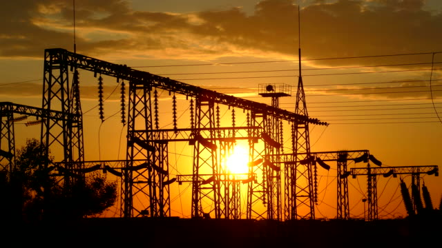 Silhouette of electric substation at sunset