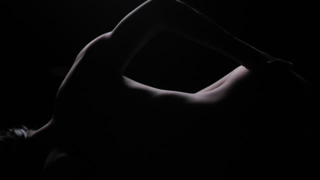 silhouette of elegant young woman erotic demonstrating her perfect sensual body in dark studio.portrait,body.real bodies - sauna stock videos & royalty-free footage