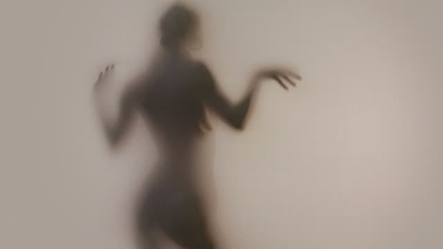 silhouette of female in shadows - sexual fetish stock videos and b-roll footage
