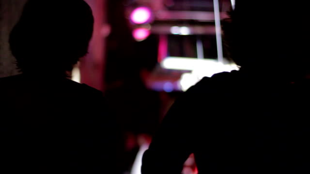 silhouette of girls dancing in a club, slow motion - club dj stock videos & royalty-free footage
