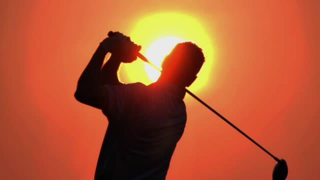 silhouette of golfers hit sweeping and keep golf course in the summer for relax time.silhouette golfer at sunset.sports cinemagraphs - golf swing stock videos & royalty-free footage