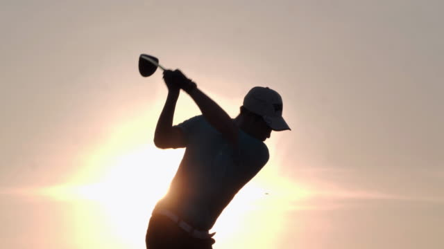 silhouette of golfers hit sweeping and keep golf course in the summer for relax time.silhouette golfer at sunset.4k sports - driving range stock videos & royalty-free footage