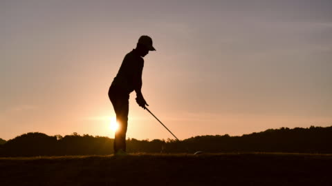 silhouette of golfers hit sweeping and keep golf course in the summer for relax time, sport concept. - green golf course stock videos & royalty-free footage