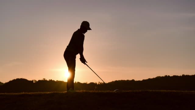 silhouette of golfers hit sweeping and keep golf course in the summer for relax time, sport concept. - golf stock videos & royalty-free footage