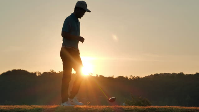 silhouette of golfers hit sweeping and keep golf course in the summer for relax time.silhouette golfer at sunset.confidence, leadership, power, skill, strength, success, sports cinemagraphs.4k sports - golf swing silhouette stock videos & royalty-free footage