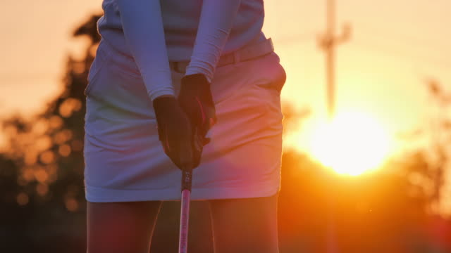 silhouette of golfers women hit sweeping and keep golf course in the summer for relax time.silhouette golfer at sunset.sports cinemagraphs.confidence,power,skill,strength,success.women in sport - golf swing silhouette stock videos & royalty-free footage