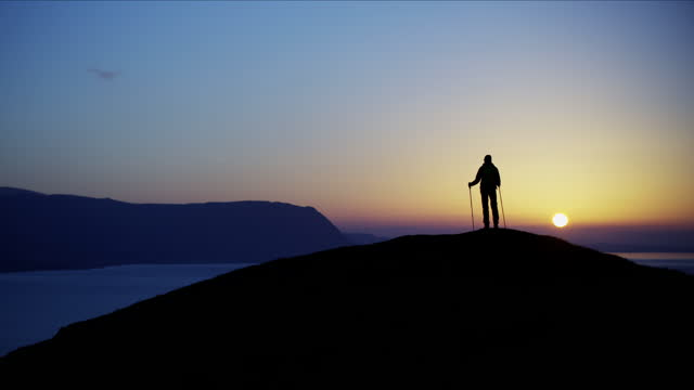 silhouette of hiker at sunrise snowdonia national park - mountain peak stock videos & royalty-free footage