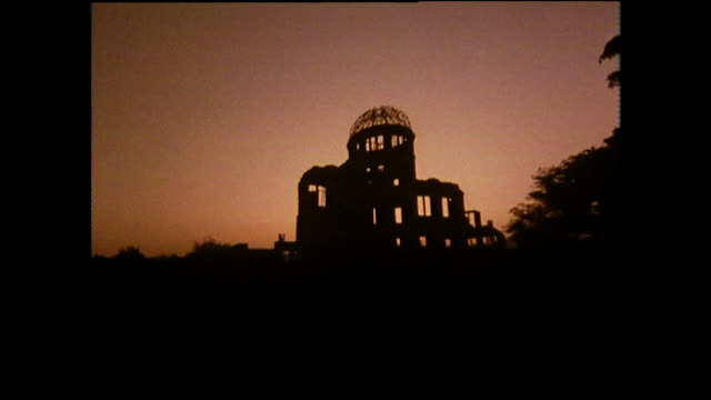silhouette of hiroshima peace memorial at sunset; 1975 - anno 1975 video stock e b–roll