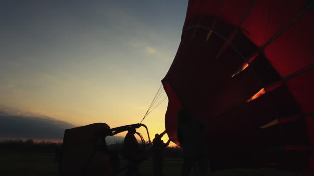 ms silhouette of hot air balloon getting ready to launch at dawn / southington, connecticut, usa - hot air balloon stock videos & royalty-free footage