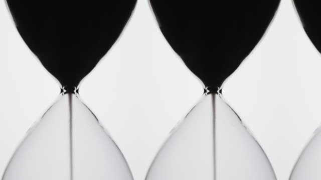 silhouette of hour glass timers. - small group of objects stock videos & royalty-free footage