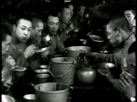 silhouette of japanese bugler. japanese soldiers eating at table rice into bowls going through inspection officer looking down barrel of rifle... - 1943 stock-videos und b-roll-filmmaterial
