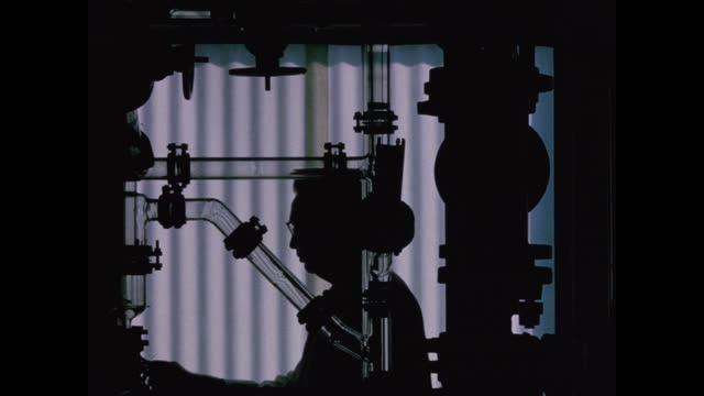 silhouette of lab technician approaching research equipment and turning it on - chemistry stock videos & royalty-free footage