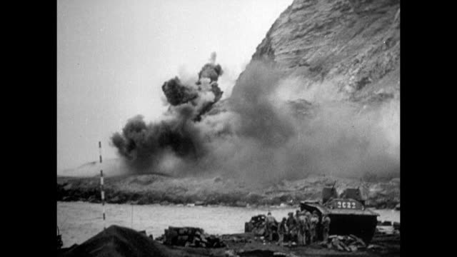 vs silhouette of light united states carrier fighter planes dropping payload of bombs onto island of iwo jima ws rocket launcher truck firing rockets... - schlacht um iwojima stock-videos und b-roll-filmmaterial
